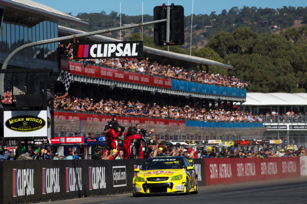2013 V8 Supercar Championship. Round 1. Clipsal 500, Adelaide. 3rd March 2013. Sunday Race 2. Shane van Gisbergen (VIP Petfoods/Tekno Autosports – Holden Commodore VF) takes the flag to win Race 2nd place Action.  World Copyright:  Daniel Kalisz/LAT Photographic Ref: Digital Image DKAL7424.jpg .