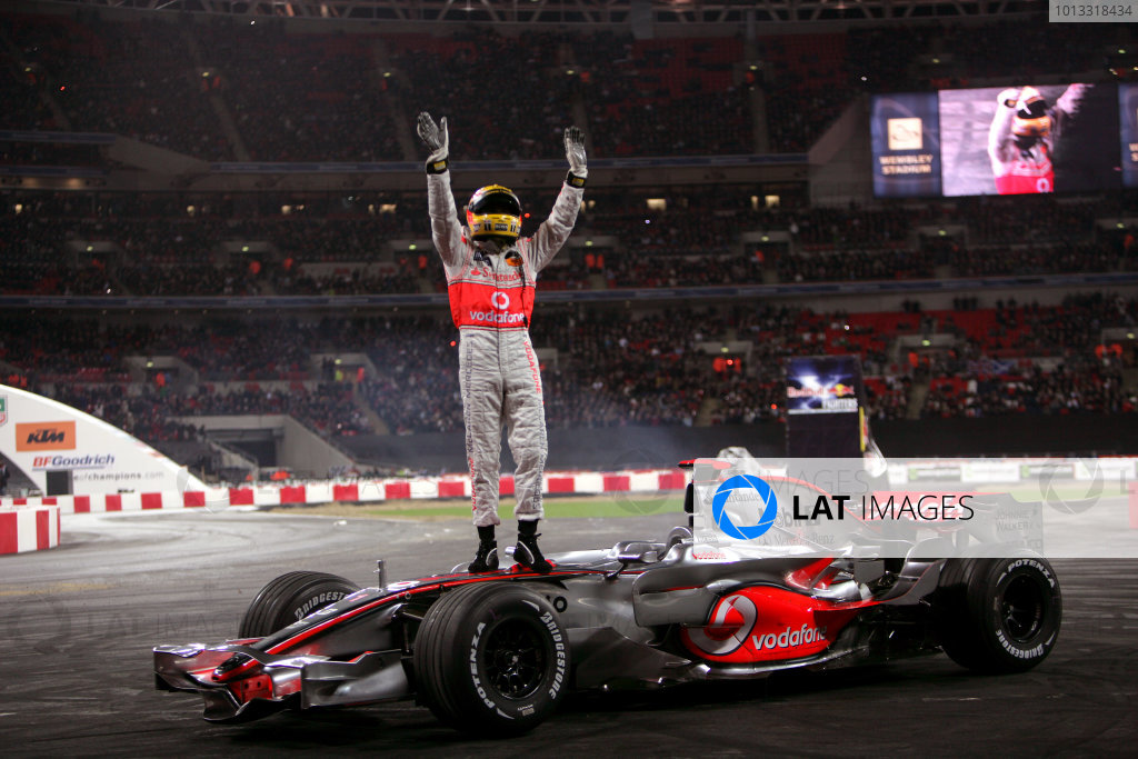 Wembley Stadium, London.  14th December 2008. Lewis Hamilton stands on top of his McLaren Mercedes F1 car as he waves to the crowd. Action. World Copyright: Andrew Ferraro/LAT Photographic ref: Digital Image VY9E4552