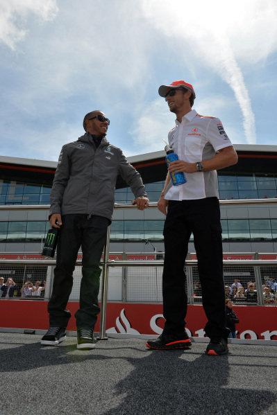 (L to R): Lewis Hamilton (GBR) Mercedes AMG F1 and Jenson Button (GBR) McLaren on the drivers parade. Formula One World Championship, Rd8, British Grand Prix, Race Day, Silverstone, England, Sunday 30 June 2013.