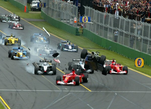 The first lap crash - Ralf Schumacher (GER) Williams BMW FW24 goes airborne