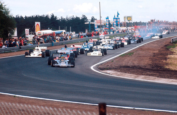 1973 Belgian Grand Prix.Zolder, Belgium.18-20 May 1973.Ronnie Peterson (Lotus 72E Ford) leads the field at the start.Ref-73 BEL 72.World Copyright - LAT Photographic