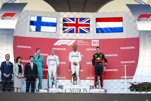 Valtteri Bottas, Mercedes AMG F1, 2nd position, Lewis Hamilton, Mercedes AMG F1, 1st position, and Max Verstappen, Red Bull Racing, 3rd position, on the podium