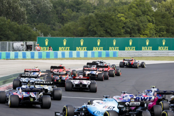 Max Verstappen, Red Bull Racing RB15, leads Valtteri Bottas, Mercedes AMG W10, Lewis Hamilton, Mercedes AMG F1 W10, Sebastian Vettel, Ferrari SF90, Charles Leclerc, Ferrari SF90, and the rest of the field at the start
