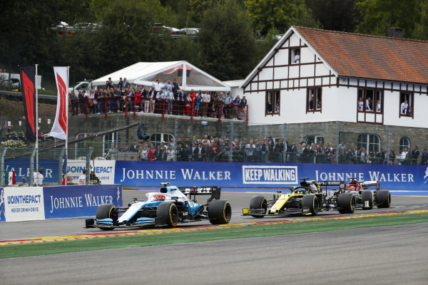 George Russell, Williams Racing FW42, leads Daniel Ricciardo, Renault R.S.19, and Kimi Raikkonen, Alfa Romeo Racing C38