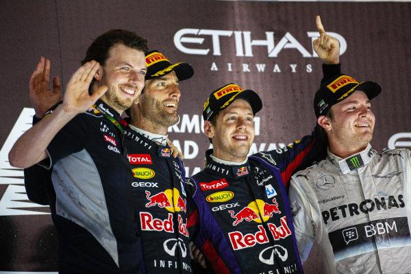 Sebastian Vettel, 1st position, Mark Webber, 2nd position, and Nico Rosberg, 3rd position, celebrate on the podium.