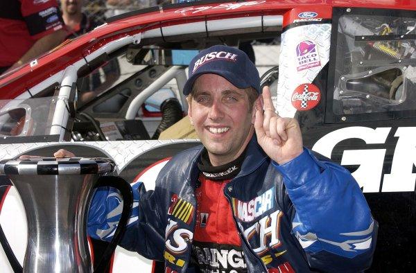2002 NASCAR Phoenix, USA November 09-10, 2002 Checker Auto Parts 500 ,Phoenix International Raceway-Greg Biffle poses with trophy after winning BGN championship,-Robt LeSieur2002LAT Photographic