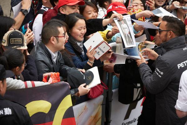 Shanghai International Circuit, Shanghai, China. Thursday 9 April 2015. Lewis Hamilton, Mercedes AMG signs autographs for fans. World Copyright: Steve Etherington/LAT Photographic. ref: Digital Image SNE26827