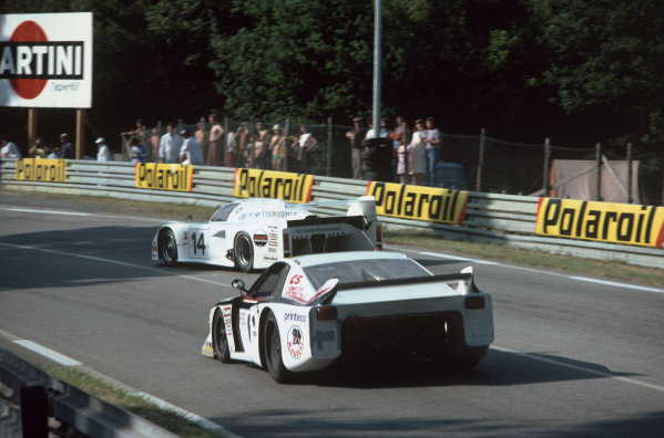 1982 Le Mans 24 hours. Le Mans, France. 19th - 20th June 1982. Jeff Wood / Eje Elgh / Patrick Neve (March 82G Chevrolet), retired, followed by Gianni Giudici / Bernard Salam / Thierry Perrier (Lancia Beta Montecarlo), retired, action. World Copyright: LAT Photographic. Ref: 82LM30.