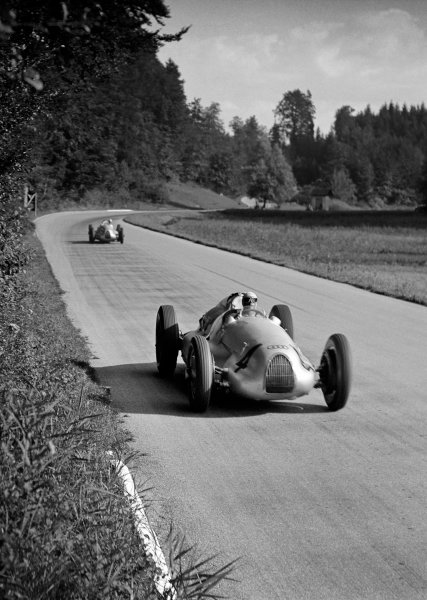 1938 Swiss Grand Prix Bremgarten, Berne, Switzerland. 21st August 1938. Hermann Muller, Auto Union D, retired, leads Hans Stuck, Auto Union D, 4th position, action. World Copyright: Robert Fellowes/LAT Photographic. Ref: 38SUI04.