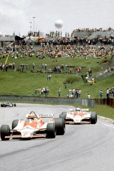 1980 Brazilian Grand Prix.Interlagos, Sao Paulo, Brazil. 25-27 January 1980.John Watson leads Alain Prost (both McLaren M29B-Ford Cosworth).World Copyright: LAT PhotographicRef: 35mm transparency 80BRA23