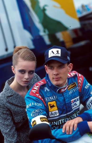 Alex Wurz (AUT), poses with a model during a photoshoot for Benetton. Formula One World Championship, French Grand Prix, Rd8, Magny-Cours, France, 29th June 1997.