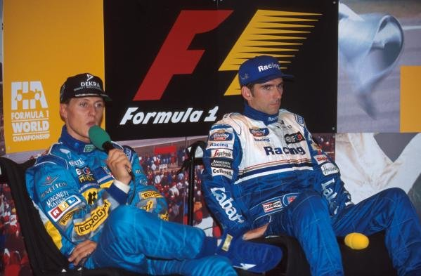 The stress on Michael Schumachers and Damon Hill's faces shows in a press conference. German GP, Hockenheim, 30 July 1995