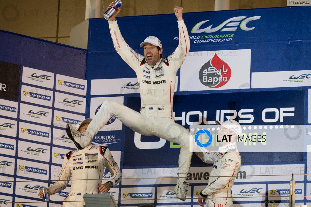 2015 WEC Bahrain International Circuit, Bahrain Saturday 21 November 2015. Mark Webber, Timo Bernhard and Brendon Hartley (#17 Porsche 919 Hybrid) celebrate on the podium after winning the drivers' championship. Photo: Sam Bloxham/LAT ref: Digital Image _SBL5903