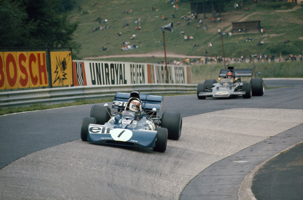 1973 German Grand Prix.  Nurburgring, Germany. 3-5th August 1973.  Jackie Stewart, Tyrrell 006 Ford, 1st position, leads Emerson Fittipaldi, Lotus 72E Ford, 6th position, into the Karussell.  Ref: 73GER14. World Copyright: LAT Photographic