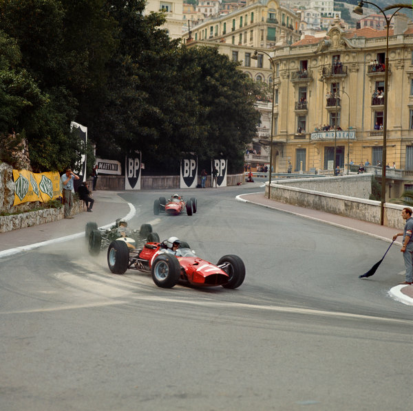 Monte Carlo, Monaco. 28-30 May 1965.  Lorenzo Bandini (Ferrari 1512) leads Jack Brabham (Brabham BT11 Climax) and John Surtees (Ferrari 158). Bandini and Surtees finished in 2nd and 4th positions respectively.  Ref-3/1619.  World Copyright - LAT Photographic
