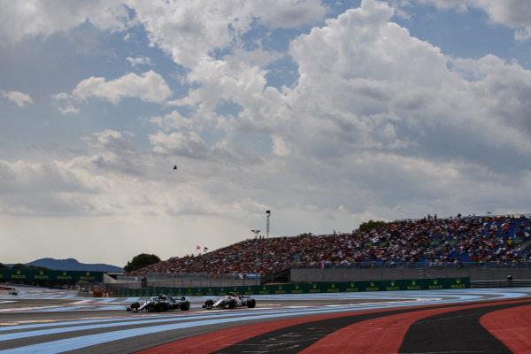 Valtteri Bottas, Mercedes AMG F1 W09, leads Charles Leclerc, Sauber C37 Ferrari.