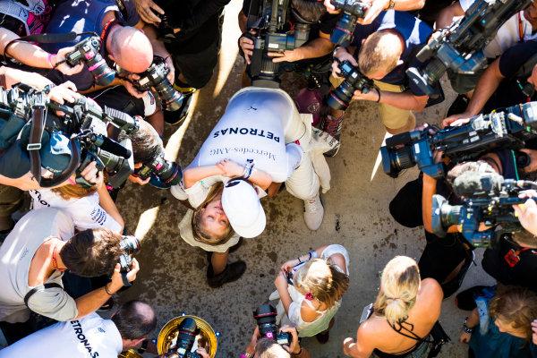 Circuit of the Americas, Austin, Texas, United States of America. Sunday 22 October 2017. Lewis Hamilton, Mercedes AMG, 1st Position, celebrates victory with friends. World Copyright: Sam Bloxham/LAT Images  ref: Digital Image _W6I8616