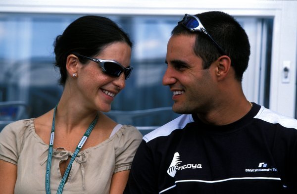 (L-R) Connie Freydel (ESP) and her fiancee Juan Pablo Montoya (COL) Williams.Formula One World Championship, Rd12, German Grand Prix, Hockenheim, Germany. 28 July 2002.BEST IMAGE