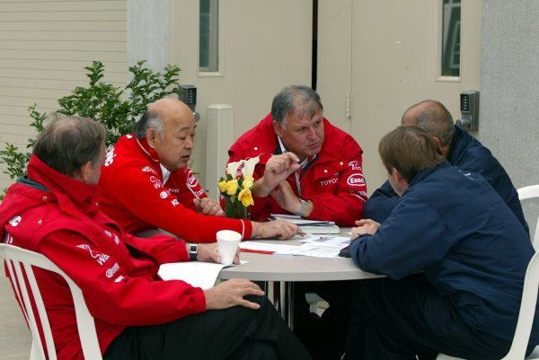 Norbert Kreyer (GER) Senior General Manager of Race and Test Engineering and other Toyota personnel discuss tactics in the paddock.Formula One World Championship, Rd15, United States Grand Prix, Race Day, Indianapolis, USA, 28 September 2003.DIGITAL IMAGE