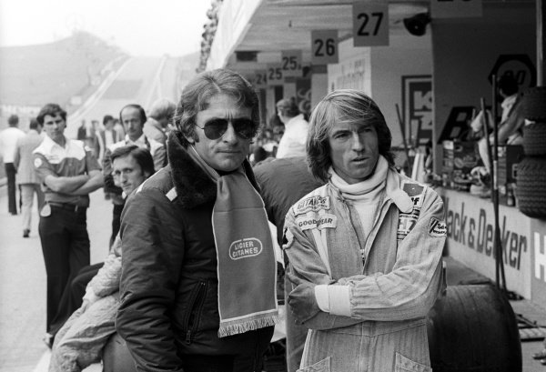 (L to R): Gerard Ducarouge (FRA) Ligier Team Manager in the pit lane with second placed Jacques Laffite (FRA) Ligier.
