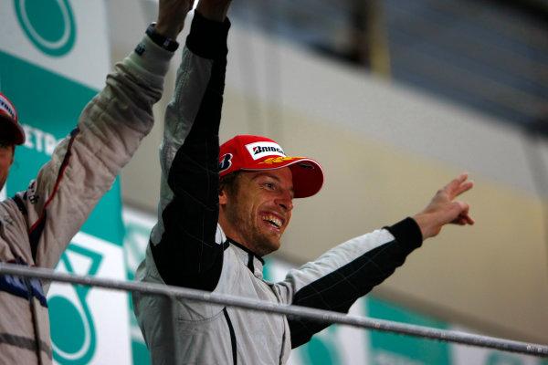 Sepang, Kuala Lumpur, Malaysia5th April 2009Jenson Button, Brawn GP BGP001 Mercedes celebrates on the podium.World Copyright: Charles Coates/LAT Photographicref: Digital Image _26Y8960