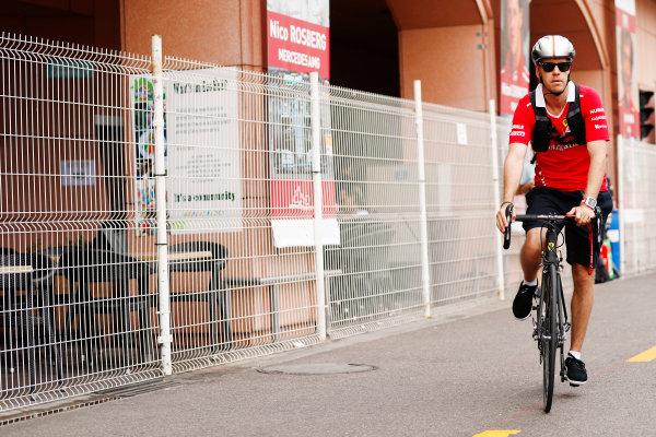Monte Carlo, Monaco. Thursday 25 May 2017. Sebastian Vettel, Ferrari, arrives in the paddock on a bike. World Copyright: Sam Bloxham/LAT Images ref: Digital Image _J6I0073