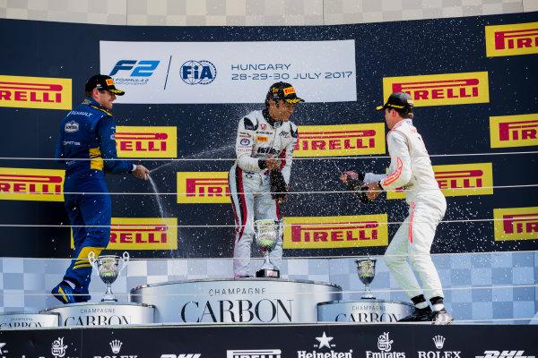 2017 FIA Formula 2 Round 7. Hungaroring, Budapest, Hungary. Sunday 30 July 2017. Oliver Rowland (GBR, DAMS), Nobuharu Matsushita (JPN, ART Grand Prix), Nyck De Vries (NED, Rapax).  Photo: Zak Mauger/FIA Formula 2. ref: Digital Image _54I4957