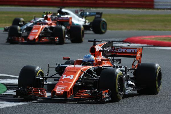 Silverstone, Northamptonshire, UK.  Friday 14 July 2017. Fernando Alonso, McLaren MCL32 Honda, leads Stoffel Vandoorne, McLaren MCL32 Honda and Lewis Hamilton, Mercedes F1 W08 EQ Power+.  World Copyright: Charles Coates/LAT Images  ref: Digital Image AN7T4319
