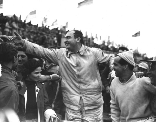 Le Mans, France. 12-13 June 1954.Jose Froilan Gonzalez and Maurice Trintignant (Ferrari) celebrate finishing in 1st position. Published-Autocar 18/6/1954 p877.World Copyright - LAT Photographic