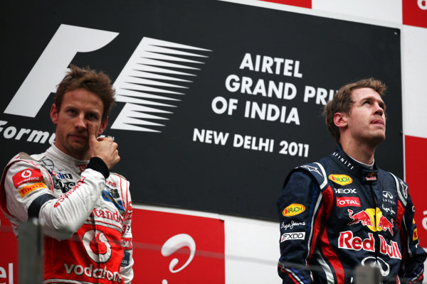 The podium (L to R): second placed Jenson Button (GBR) McLaren with race winner Sebastian Vettel (GER) Red Bull Racing. Formula One World Championship, Rd 17, Indian Grand Prix, Buddh International Circuit, Greater Noida, New Delhi, India, Race, Sunday 30 October 2011.   BEST IMAGE