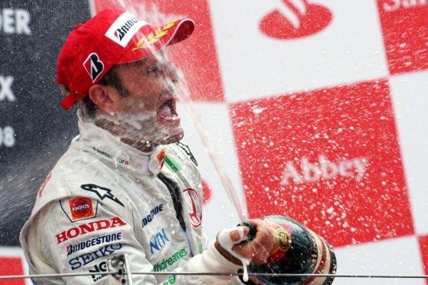 Rubens Barrichello (BRA) Honda Racing F1 Team celebrates his third position on the podium. Formula One World Championship, Rd 9, British Grand Prix, Race, Silverstone, England, Sunday 6 July 2008.