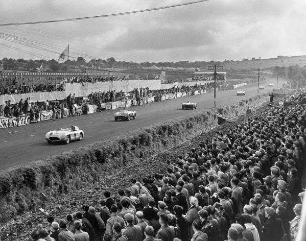 Dundrod, Great Britain. 17th September 1955.Juan Manuel Fangio/Karl Kling (Mercedes-Benz 300SLR), 2nd position, leads Umberto Maglioli/Maurice Trintignant  (Ferrari 857 Monza), 8th position, action. World Copyright: LAT Photographic.Ref:  B/W Print