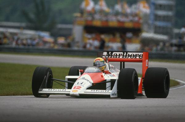 Jacarepagua, Rio de Janeiro, Brazil.1-3 April 1988.Ayrton Senna (McLaren MP4/4 Honda), DQ, action.  World Copyright: LAT Photographic.Ref: 88BRA26.