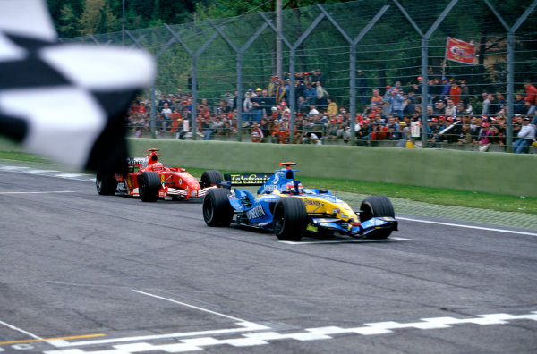 2005 San Marino Grand PrixImola, Italy. 22nd - 24th April 2005.Race winner Fernando Alonso, Renault R25 (1st), takes the chequered flag, closely followed by Michael Schumacher, Ferrari F2005. Action.Photo: Charles Coates/LAT Photographic ref: 35mm Image 05SanMA01