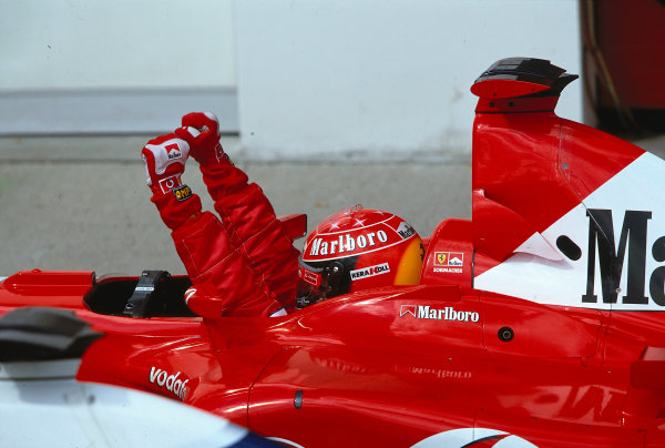 2002 San Marino Grand Prix.Imola, Italy.12-14 April 2002.Michael Schumacher (Ferrari F2002) celebrates his 1st position in parc ferme.Ref-02 SM 28.World Copyright - LAT Photographic