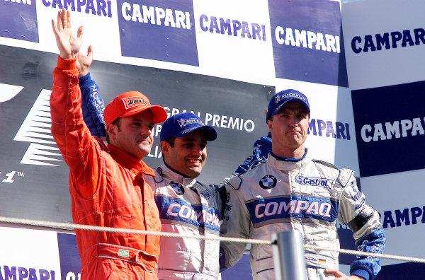 2001 Italian Grand Prix - RaceMonza, Italy. 16th Spetember 2001.Juan Pablo Montoya, BMW Williams FW23, 1st, Rubens Barrichello, Ferrari F2001, 2nd and Ralf Schumacher, BMW Williams FW23, 3rd. Race podium.World Copyright: Steve Etherington/ LAT Photographicref: 17 5mb Digital Image