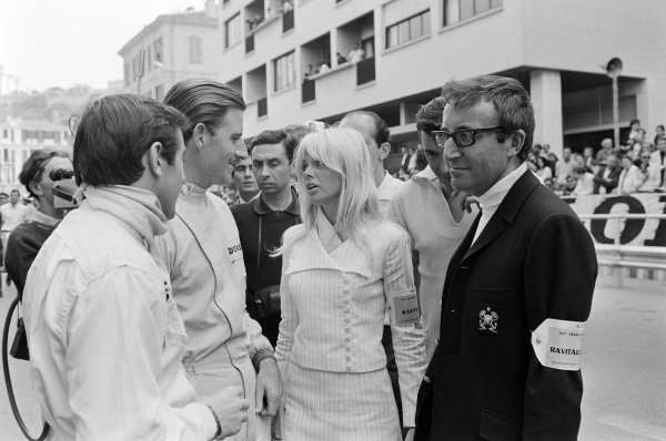 Jackie Stewart and Graham Hill talk with actor Peter Sellers and his wife Britt Ekland.