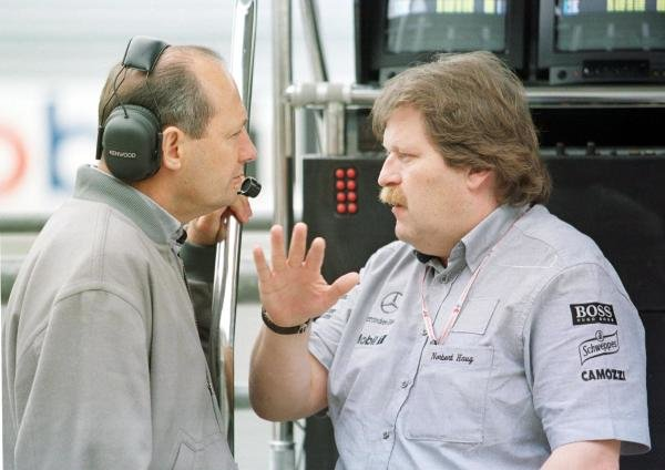 1998 French Grand Prix.Magny-Cours, Nevers, France.26-28 June 1998.McLaren Mercedes-Benz boss Ron Dennis talks to Norbert Haug of Daimler-Benz Motorsport on the pitlane wall.World Copyright - Steve Etherington/LAT Photographic