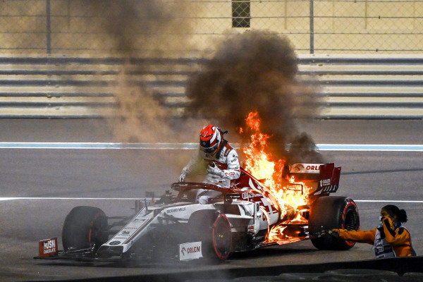 Abu Dhabi GP: Kimi Raikkonen, Alfa Romeo Racing C39, climbs from his car while the rear is engulfed in flames