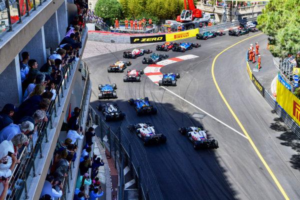 Sir Lewis Hamilton, Mercedes W12, leads Sebastian Vettel, Aston Martin AMR21, Esteban Ocon, Alpine A521, Sergio Perez, Red Bull Racing RB16B, Antonio Giovinazzi, Alfa Romeo Racing C41, Lance Stroll, Aston Martin AMR21, and the remainder of the field at the start