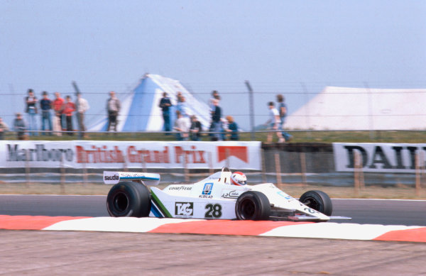 1979 British Grand Prix. Silverstone, England. 12-14 July 1979. Clay Regazzoni (Williams FW07-Ford) 1st position. This was Williams Grand Prix Engineering's maiden Grand Prix victory.  Ref-79 GB 06. World Copyright - LAT Photographic