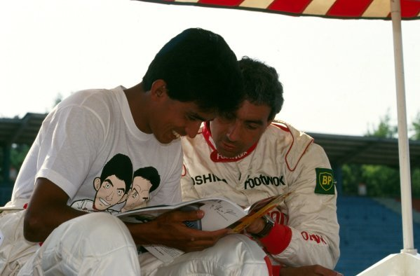Aguri Suzuki (JPN) Footwork chats with teammate Michele Alboreto (ITA).