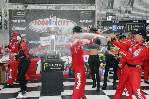 #18: Kyle Busch, Joe Gibbs Racing, Toyota Camry Skittles celebrates in victory lane