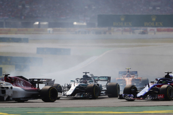 Lewis Hamilton, Mercedes AMG F1 W09, passes Brendon Hartley, Toro Rosso STR13 Honda, on the first lap.