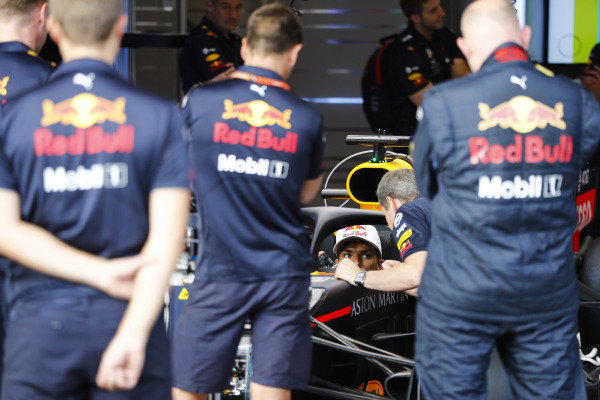 Pierre Gasly, Toro Rosso, sits in a Red Bull Racing RB14.