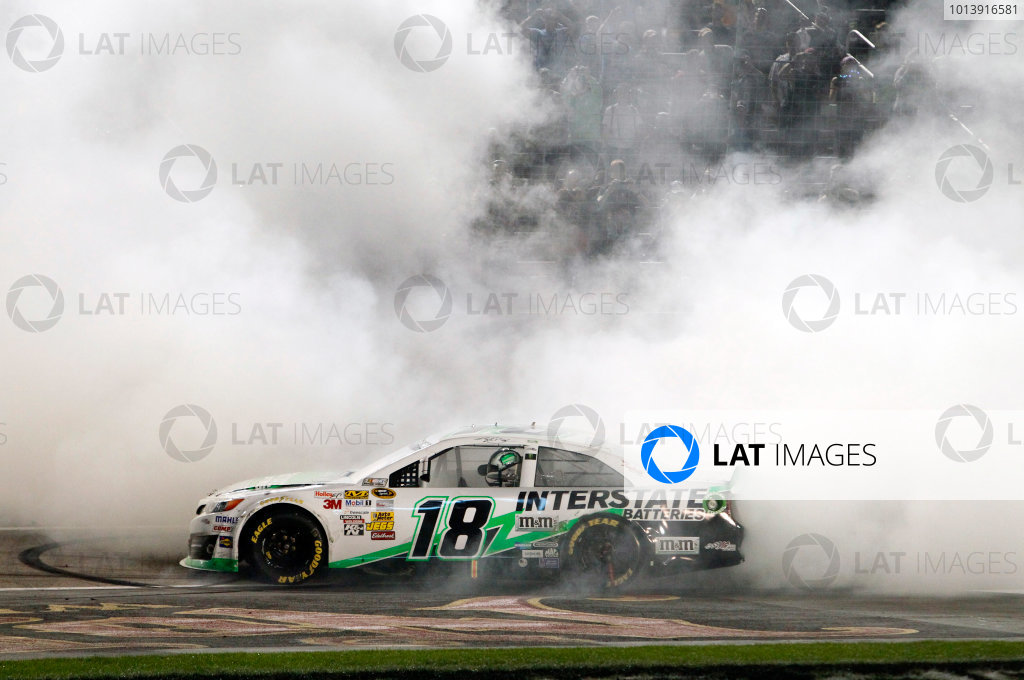 11-13 April, 2013, Fort Worth, Texas USA Kyle Busch, Interstate Batteries Toyota Camry celebrates his win with a burnout ©2013, Matt Thacker LAT Photo USA