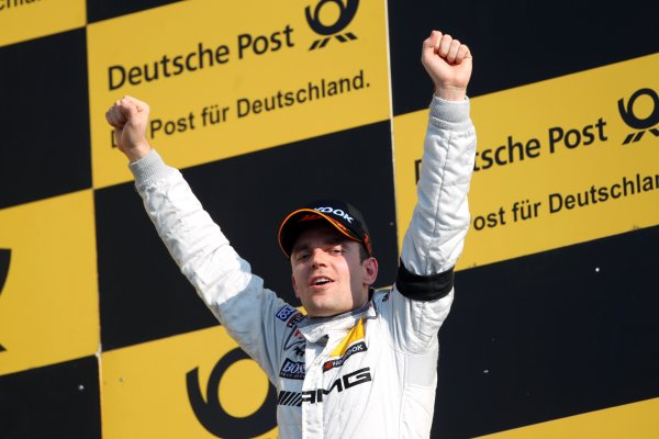Race winner Jamie Green (GBR), AMG Mercedes, celebrates on the podium.DTM, Rd10, Hockenheim, Germany, 22-23 October 2011 World Copyright: LAT Photographicref: Digital Image dne1123oc73