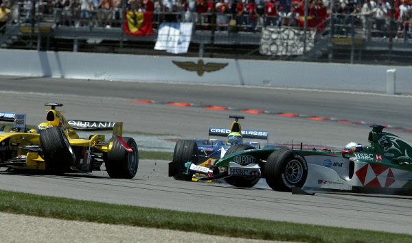 2004 United States Grand Prix - Sunday Race,2004 United States Grand PrixIndianapolis, USA. 20th June 2004 Felipe Massa, Sauber Petronas C23 Christian Klien, Jaguar R5 and Giorgio Pantano, Jordan Ford EJ14 end their races with a crash in the first corner caused when Klien was unable to avoid a slowing Cristiano Da Matta, Toyota TF104. Action.World Copyright: Steve Etherington/LAT Photographic ref: Digital Image Only