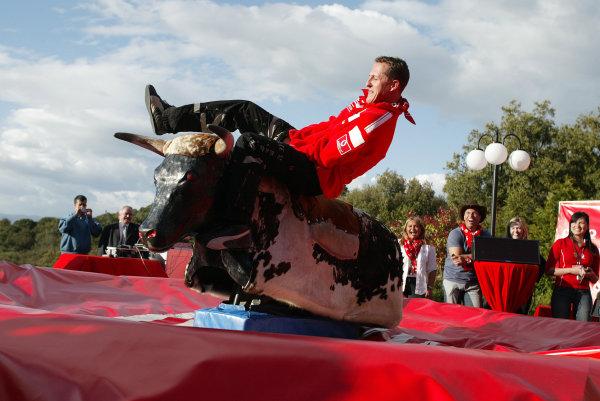 2004 Spanish Grand Prix - Thursday,Barcelona, Spain. 6th May 2004 Michael Schumacher, Ferrari F2004, gest into the swing of things ona 'Bucking Bronco'.World Copyright: Steve Etherington/LAT Photographic ref: Digital Image Only