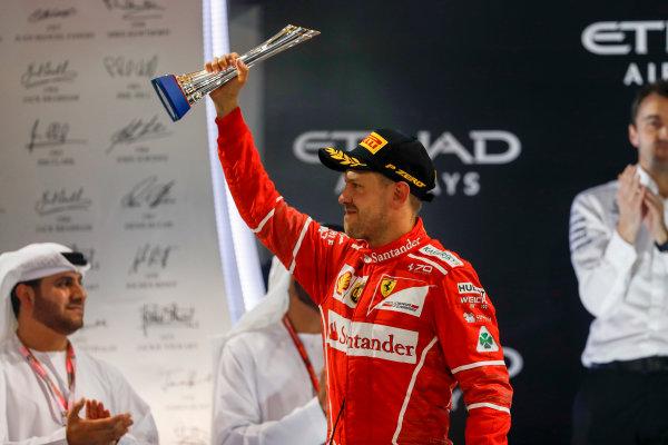 Yas Marina Circuit, Abu Dhabi, United Arab Emirates. Sunday 26 November 2017. Sebastian Vettel, Ferrari, on the podium. World Copyright: Glenn Dunbar/LAT Images  ref: Digital Image _X4I9835